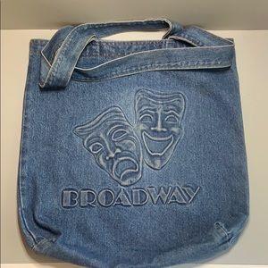 Denim tote bag embossed w/happy sad face masks